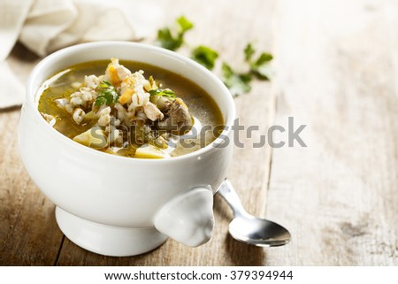 Soup with barley and chicken hearts - stock photo