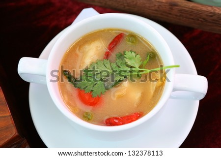 Soup with beans and dumplings in soup bowl
