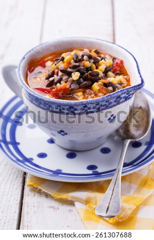 Soup with black beans,buckwheat, red pepper and corn. - stock photo
