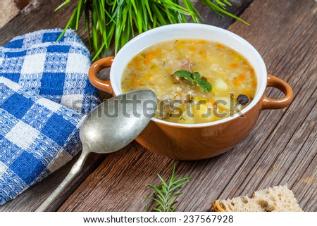 Soup with buckwheat, vegetables and chicken stomachs. Selective focus. - stock photo