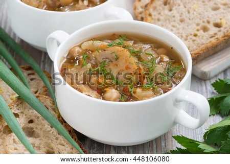 soup with cabbage and mushrooms, closeup, horizontal