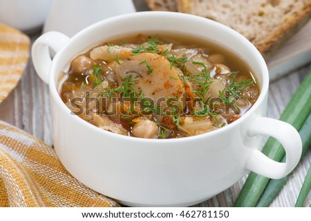 soup with cabbage and mushrooms in bowl, closeup, horizontal