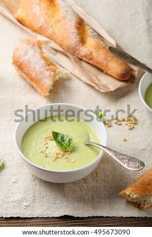 Soup with cheese and bread on table, food closeup