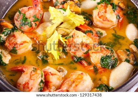 Soup with fish and seafood - stock photo