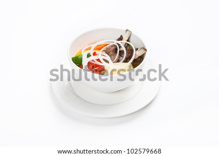 soup with meat and vegetables with white background - stock photo