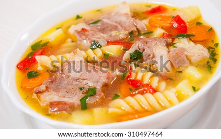 soup with meat, pasta and vegetables