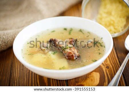 soup with meat skewers