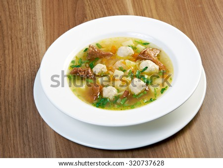 soup with meatballs and chanterelles - stock photo