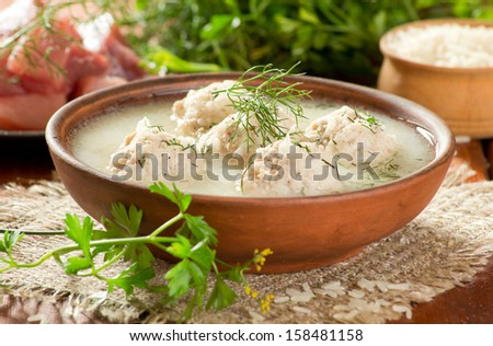 Soup with meatballs and dill
