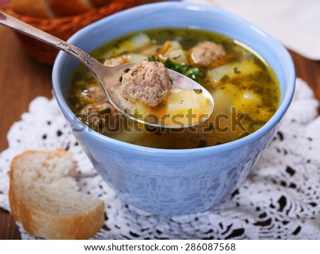 Soup with meatballs and vegetables - stock photo