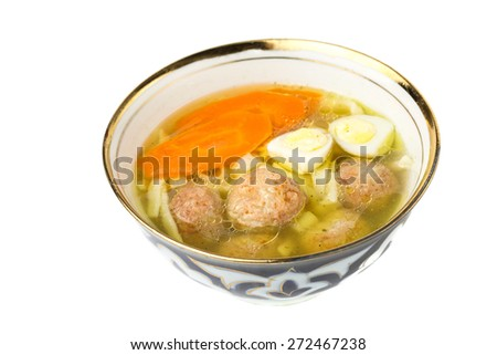 soup with meatballs, carrots and egg. on a white background