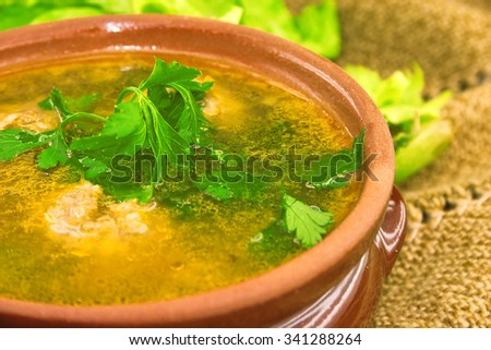 Soup with meatballs in ceramic bowl. Selective focus. - stock photo
