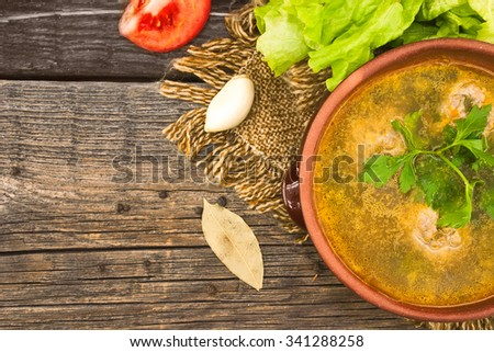 Soup with meatballs in ceramic bowl. Top view. - stock photo