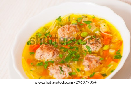 Soup with meatballs, noodle and vegetables - stock photo