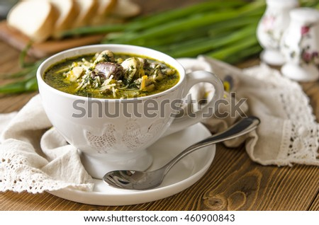 Soup with mushrooms paste offal carrots and herbs