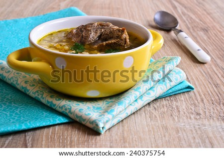 Soup with pearl barley, vegetables and meat in a bowl - stock photo