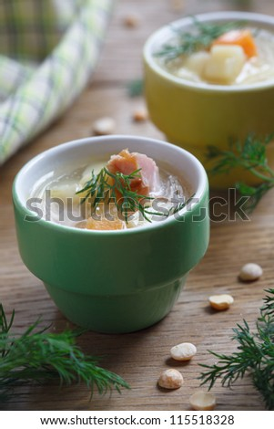 Soup with peas, carrot and smoked meat