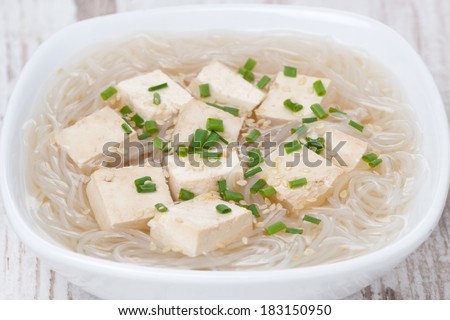 soup with rice noodles, tofu and green onions, close-up, horizontal - stock photo