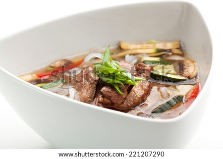 Soup with Rice Noodles, Veal and Vegetables - stock photo