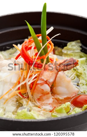 Soup with Seafoods and Chicken, Vegetables and Salad Leaf. Garnished with Lettuce - stock photo