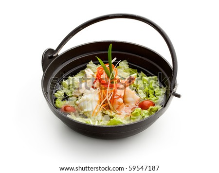 Soup with Seafoods and Chicken, Vegetables and Salad Leaf. Garnished with Lettuce