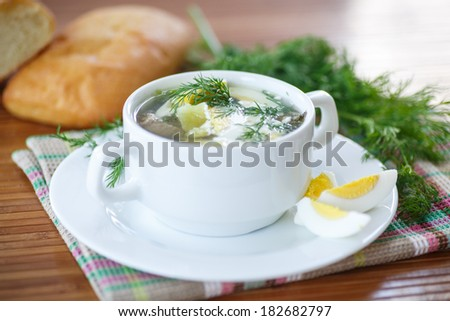 soup with sorrel and eggs in a bowl on the table