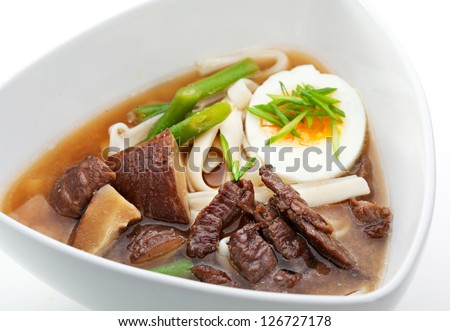 Soup with Udon (japanese noodles), Veal, Mushrooms and Egg - stock photo