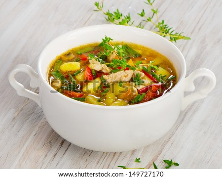 Soup with vegetables and chicken.Selective focus - stock photo