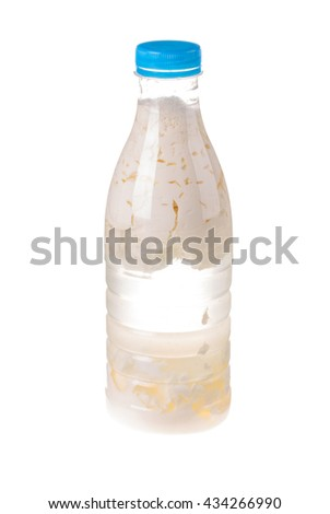 Sour milk in a plastic bottle. Isolated on the white background. - stock photo