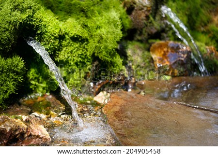 source of spring water - stock photo