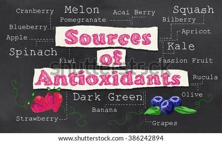Sources of Antioxidants with Chalk on Blackboard - stock photo