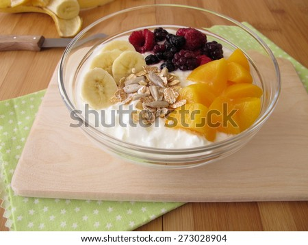 Soured milk with fruits, cereals and chia seeds - stock photo