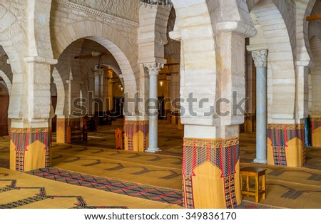 SOUSSE, TUNISIA - SEPTEMBER 6, 2015: The interior of the Grand Mosque with many rows of stone arcades and ancient columns, on September 6 in Sousse.