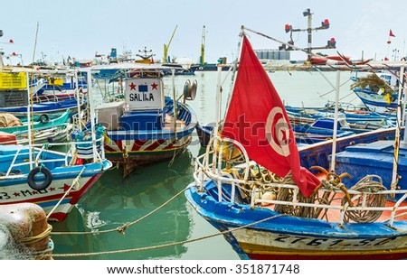 SOUSSE, TUNISIA - SEPTEMBER 6, 2015: The old colorful fishing boats moored in harbor, on September 6 in Sousse.