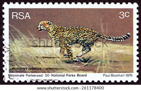 """SOUTH AFRICA - CIRCA 1976: A stamp printed in South Africa from the """"World Environment Day"""" issue shows Cheetah (Acinonyx jubatus), circa 1976. - stock photo"""