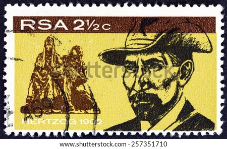 SOUTH AFRICA - CIRCA 1968: A stamp printed in South Africa issued for the inauguration of General Hertzog monument, Bloemfontein shows Hertzog in 1902, circa 1968. - stock photo