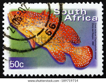 SOUTH AFRICA - CIRCA 2000: a stamp printed in South Africa shows Coral Rockcod, Cephalopholis Miniata, Marine Fish, circa 2000 - stock photo