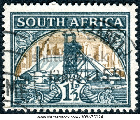 SOUTH AFRICA - CIRCA 1936: Postage stamp printed in South Africa, shows Gold Mine, circa 1936