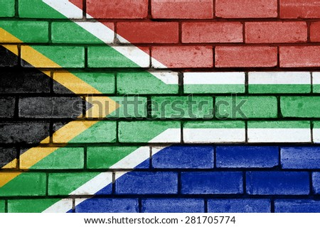 South Africa flag painted on old brick wall texture background - stock photo
