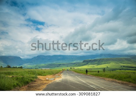 South Africa - January 19 2015: Trip by car through the picturesque landscapes of Kwazulu Natal to get to the Drakensberg National Park
