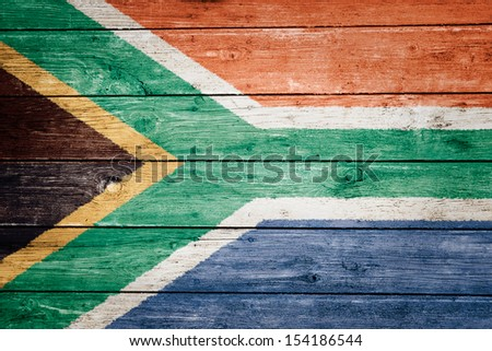 south african flag on wood texture background - stock photo