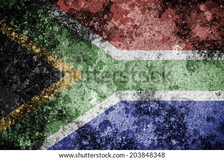South African flag over a grunge concrete background. - stock photo