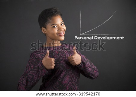 South African or African American black woman teacher or student with a thumbs up hand signal to personal development standing against a chalk blackboard background inside - stock photo