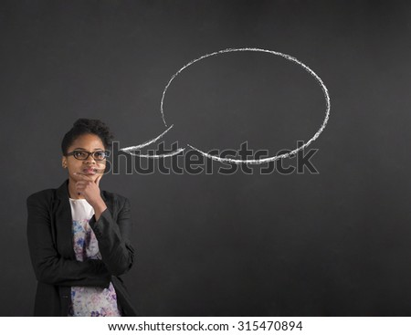 South African or African American black woman teacher or student with her hand on her chin whilst thinking thought bubble standing against a chalk blackboard background inside