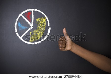 South African or African American teacher or student with thumbs up against a blackboard background with a chalk pie graph or chart - stock photo