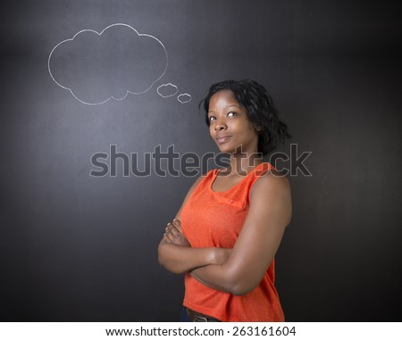 South African or African American woman teacher or student thinking with thought clouds - stock photo