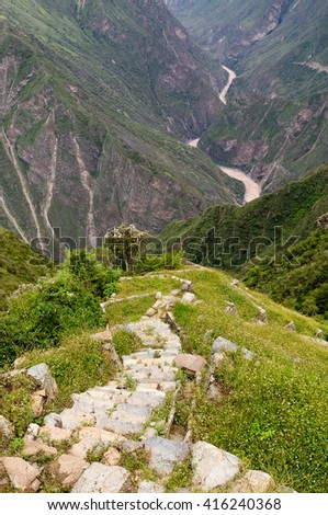 South America - Choquequirao lost ruins (mini - Machu Picchu), remote, spectacular the Inca ruins near Cuzco. Cultivated terrace fields on the steep sides of a mountain - stock photo