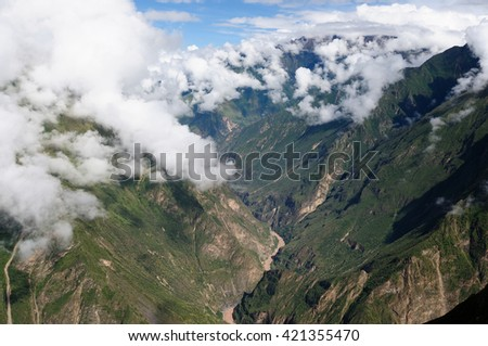 South America - Choquequirao lost ruins (mini - Machu Picchu), remote, spectacular the Inca ruins near Cuzco. The view from ruins on nearby tops and canyon - stock photo
