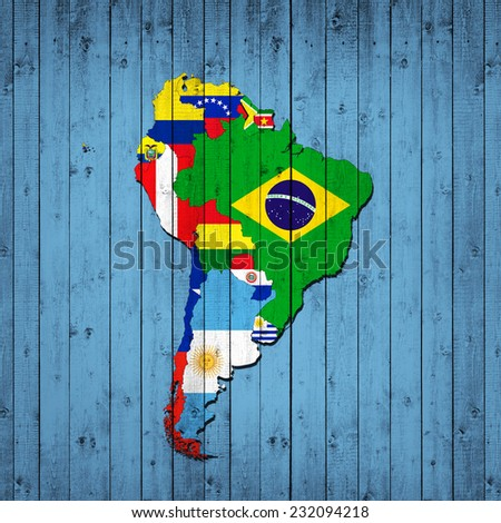 South America,continent, flags, maps,and wood background