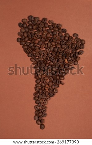 South America continent map made of coffee beans on brown background - stock photo